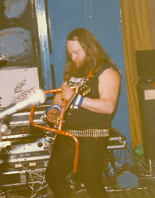 Dumpy, shown here without his Rusty Nuts, on (for reasons which escape me) handlebar at a Rock Soc gig.